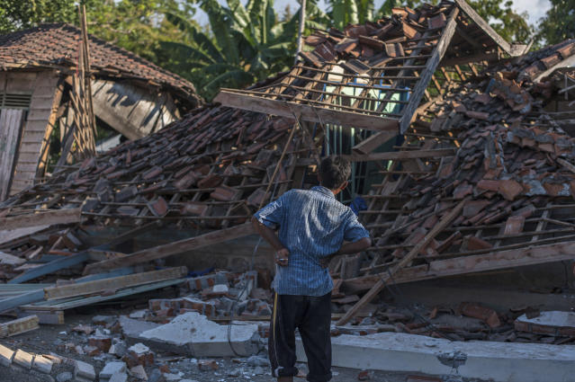 <p>A man inspects the ruins of houses at a village affected by Sunday's earthquake in Kayangan, Lombok Island, Indonesia, Tuesday, Aug. 7, 2018. (Photo: Fauzy Chaniago/AP) </p>