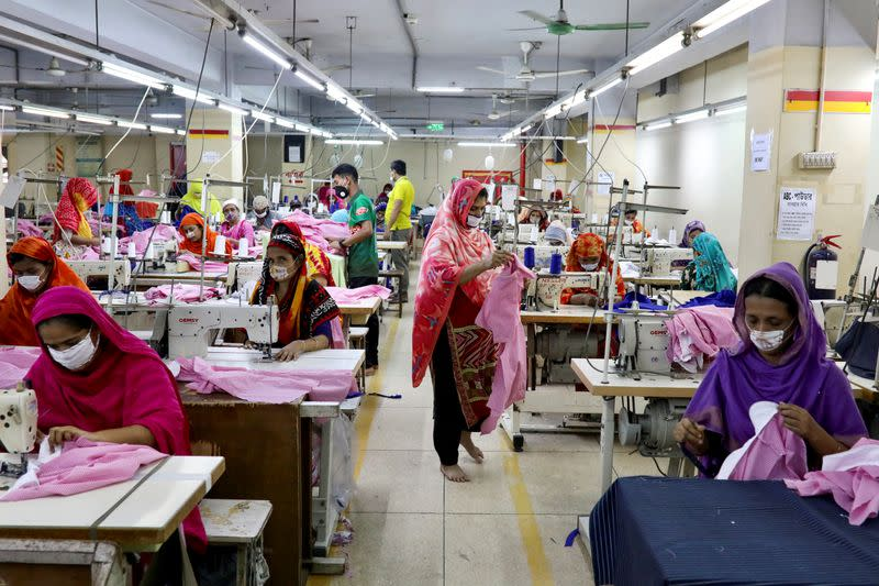 FILE PHOTO: Women work in a garment factory, as factories reopened after the government has eased the restrictions amid concerns over coronavirus disease (COVID-19) outbreak in Dhaka
