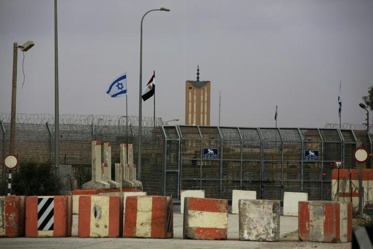 Israeli and Egyptian flags seen at the Nitzana border crossing along their border near the Israeli village of Nitzanei Sinai
