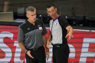 FILE - In this Monday, Aug. 31, 2020, file photo, then-Oklahoma City Thunder head coach Billy Donovan, left, talks with an official during the second half of an NBA first-round playoff basketball game against the Houston Rockets, in Lake Buena Vista, Fla. The Chicago Bulls made sweeping changes to their front office for the 2020-21 season and snagged Donovan, one of the top coaches on the market, hoping an overhaul in leadership will carry them back to respectability. (AP Photo/Mark J. Terrill, File)