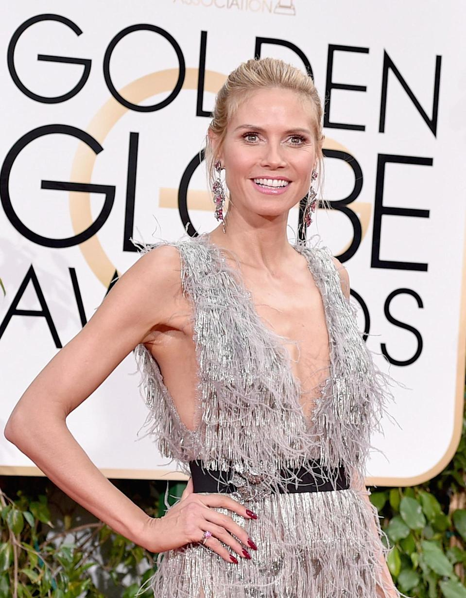 <p>Klum hit the slopes for Christmas vacation, but we're not seeing any goggle tans tonight.<i> (Photo: Getty Images)</i></p>
