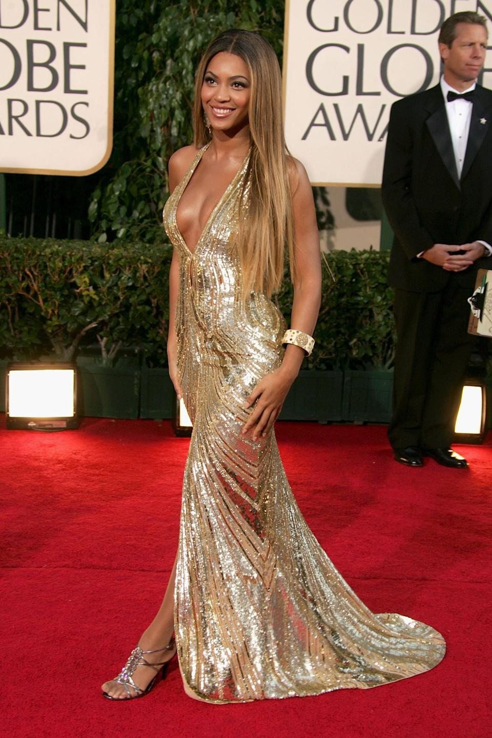 """<strong><h2>2007</h2></strong><br>Not that there's anything Queen Bey <em>doesn't</em> look stunning in, but even she outdid herself with this gold, sequined Elie Saab number.<br><br><em>Beyonce Knowles in Elie Saab.</em><span class=""""copyright"""">Photo: Frazer Harrison/Getty Images.</span>"""