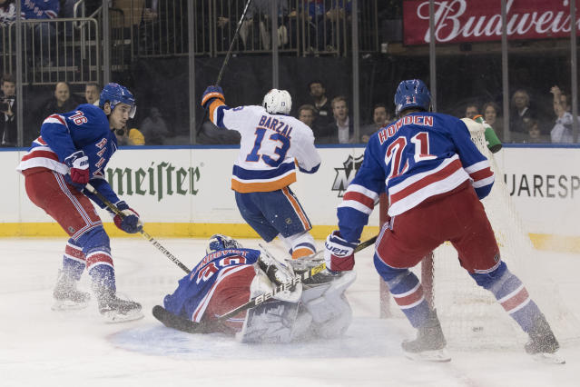 New York Islanders center Mathew Barzal (13) reacts after scoring a goal past New York Rangers goaltender Henrik Lundqvist (30) during the first period of an NHL hockey game, Thursday, Jan. 10, 2019, at Madison Square Garden in New York. (AP Photo/Mary Altaffer)