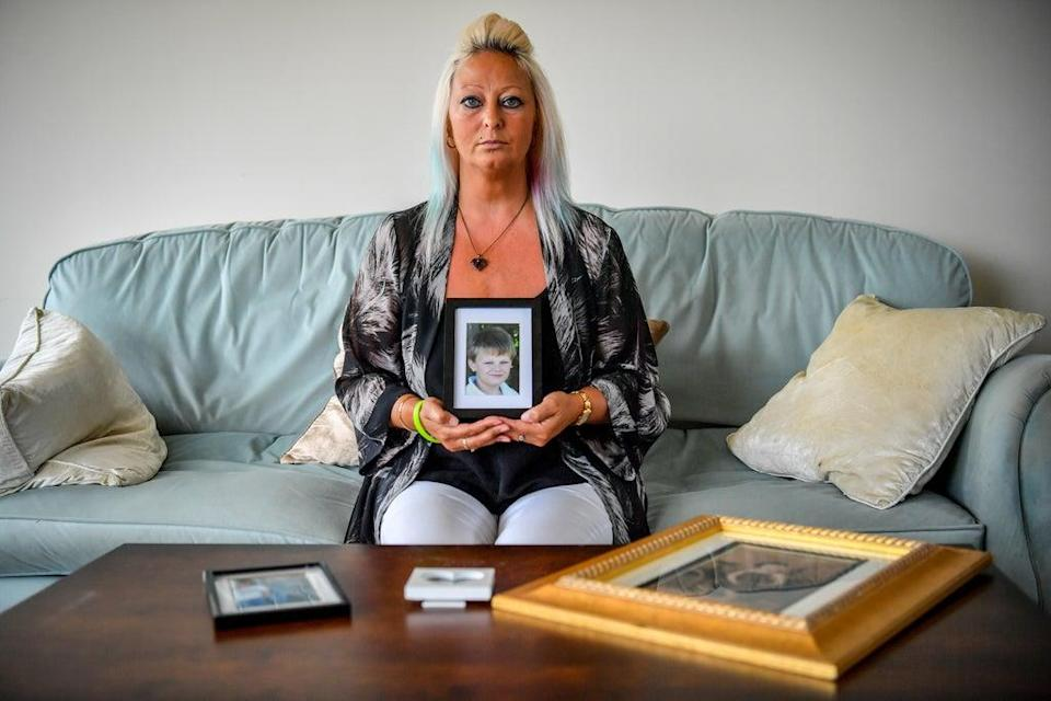 Charlotte Charles, mother of Harry Dunn, holding a photograph of him aged 14 (Family Handout/PA) (PA Media)
