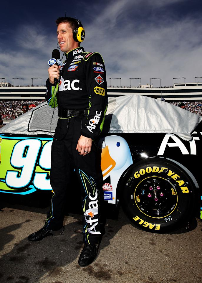 LAS VEGAS, NV - MARCH 11:  Carl Edwards, driver of the #99 Aflac Ford, stands on the grid prior to the start of the NASCAR Sprint Cup Series Kobalt Tools 400 at Las Vegas Motor Speedway on March 11, 2012 in Las Vegas, Nevada.  (Photo by Jeff Bottari/Getty Images for NASCAR)