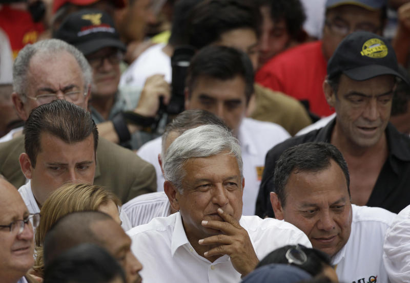 Andres Manuel Lopez Obrador, center, presidential candidate for the Democratic Revolution Party (PRD) pauses as he walks with supporters towards the main Zocalo plaza during a massive march for the final campaign closing rally in Mexico City, Mexico, Wednesday, June 27, 2012. Next July 1, Mexico will hold presidential elections. (AP Photo/Dario Lopez-Mills)