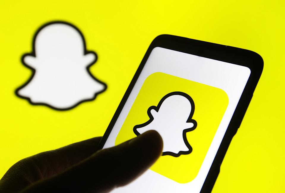 This illustration picture taken on 15 January 2021 shows the Snapchat logo displayed on a smartphone screen (Photo illustration by STR/NurPhoto via Getty Images)