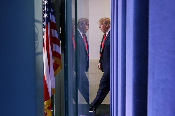 US President Donald Trump arrives to make a statement in the briefing room at the White House in Washington.