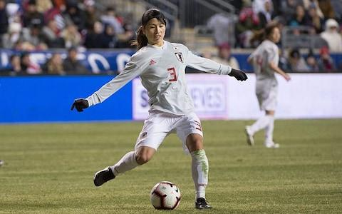 Japan player kicks ball wearing away kit - Credit: REX