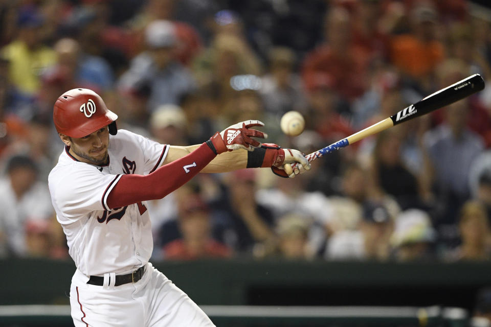 Washington Nationals' Trea Turner fouls off a pitch during the eighth inning of the team's baseball game against the Miami Marlins, Wednesday, July 21, 2021, in Washington. The Marlins won 3-1. (AP Photo/Nick Wass)