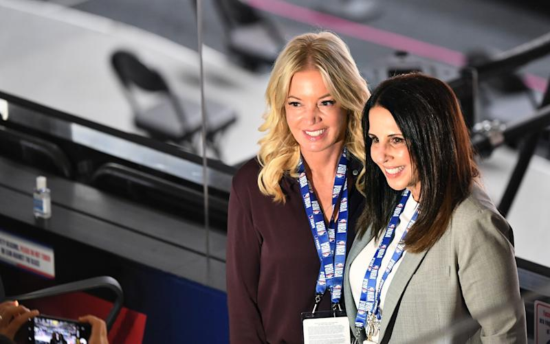 Jeanie Buss and Linda Rambis pose for a photo before Game 2 of the NBA FInals.
