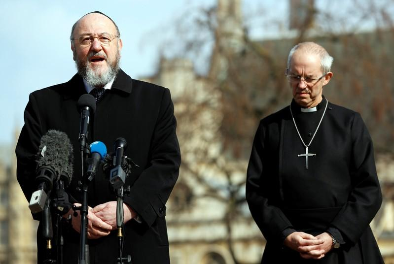 FILE PHOTO: Britain's Archbishop of Canterbury, Justin Welby, listens to the Chief Rabbi, Ephraim Mirvis speak to the media following a recent attack in Westminster, London