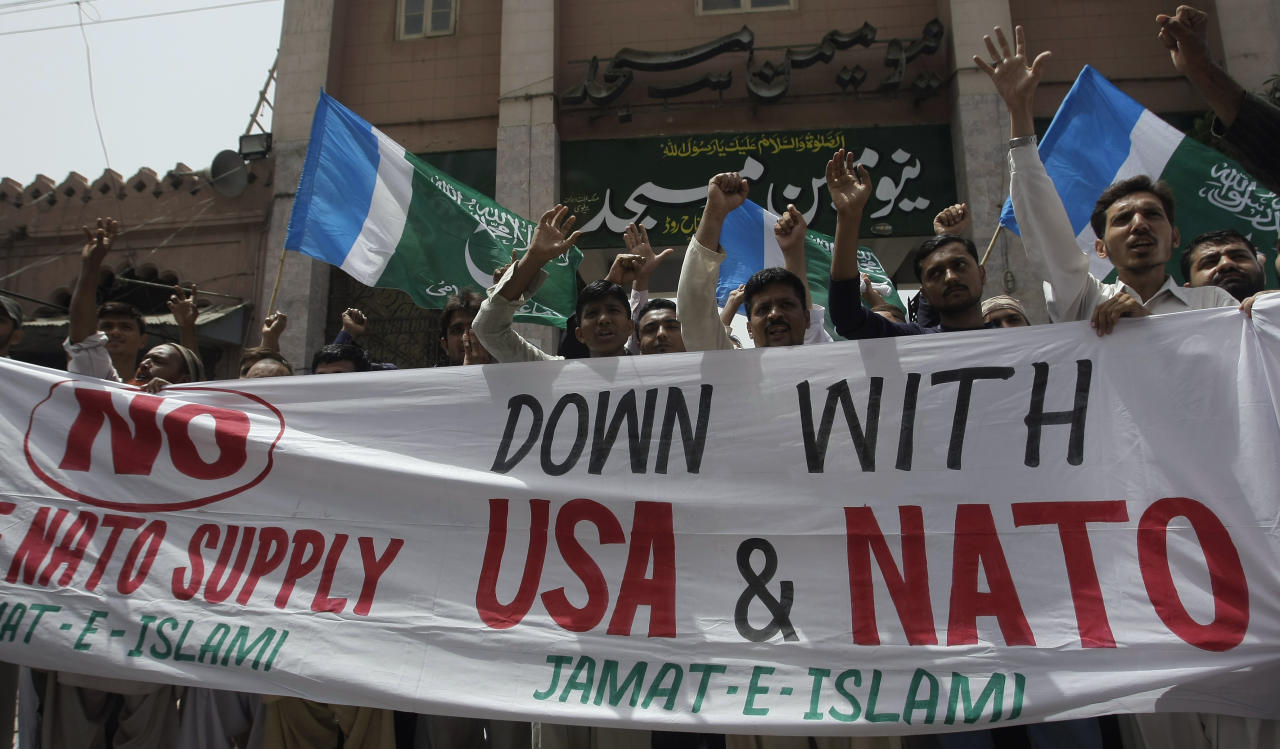 Supporters of a Pakistani religious party Jamaat-e-Islami chant anti-American slogans during a rally against a possible resumption of of NATO supplies to neighboring Afghanistan, Friday, May 25, 2012 in Karachi, Pakistan. Pakistan's parliament has unanimously approved new guidelines for the country in its troubled relationship with the United States, a decision that could pave the way for the reopening of supply lines to NATO troops in neighboring Afghanistan. (AP Photo/Fareed Khan)