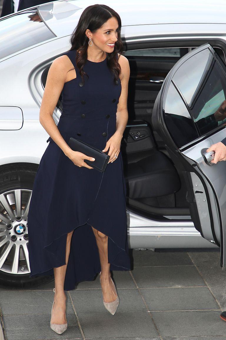 <p>Wearing the same heels as earlier in the day, she paired them with an Antonio Beradi dress she wore for her first ever event with Prince Harry - the Audi Polo Challenge in May 2017.</p>