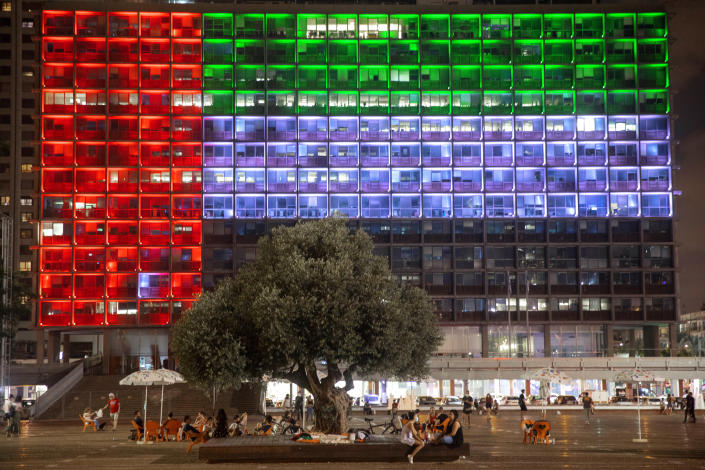 """Tel Aviv City Hall is lit up with the flags of the United Arab Emirates and Israel as the countries announced they would be establishing full diplomatic ties, in Tel Aviv, Israel, Thursday, Aug. 13, 2020. In a nationally broadcast statement, Prime Minister Benjamin Netanyahu said the """"full and official peace"""" with the UAE would lead to cooperation in many spheres between the countries and a """"wonderful future"""" for citizens of both countries. (AP Photo/Oded Balilty)"""