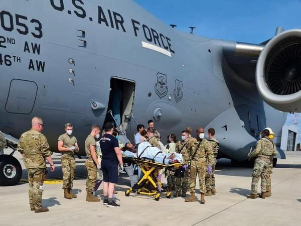 An Afghan woman gave birth aboard a U.S. evacuation flight upon landing at the Ramstein Air Base in Germany on Saturday. (Photo Credit:  Air Mobility Command twitter)