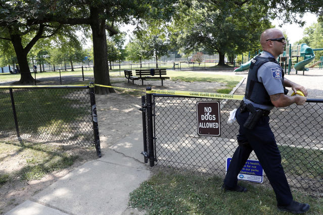 <p>An Alexandria, Va. police officer marks off a playground near the baseball field in Alexandria, Va., Wednesday, June 14, 2017, that was the scene of a shooting where House Majority Whip Steve Scalise of La., and others were shot during a congressional baseball practice. (Photo: Alex Brandon/AP) </p>