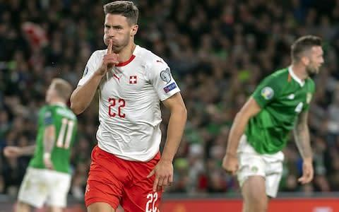 <span>Newcastle defender Fabian Schar opened the scoring for the Swiss</span> <span>Credit: REX </span>