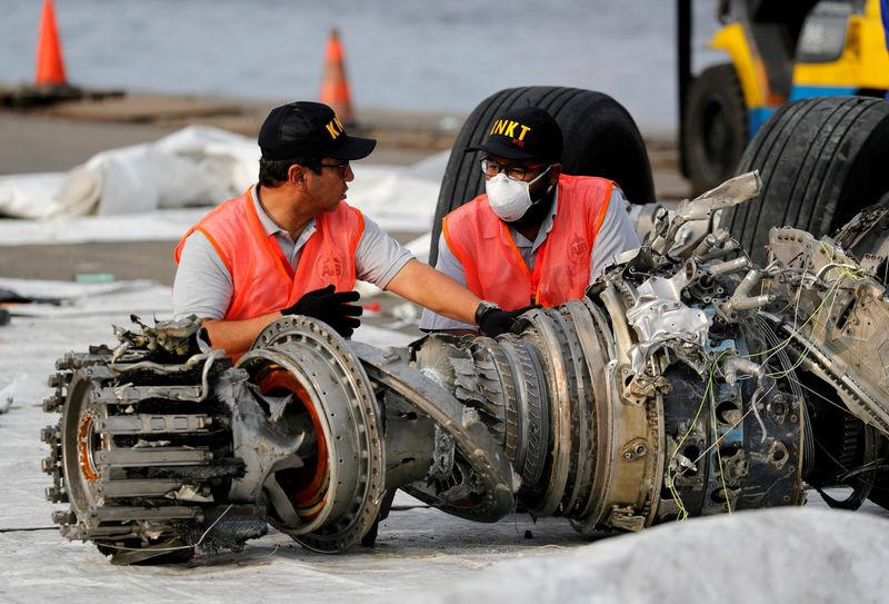 FILE PHOTO: KNKT officials examine a turbine engine from the Lion Air flight JT610 at Tanjung Priok port in Jakarta