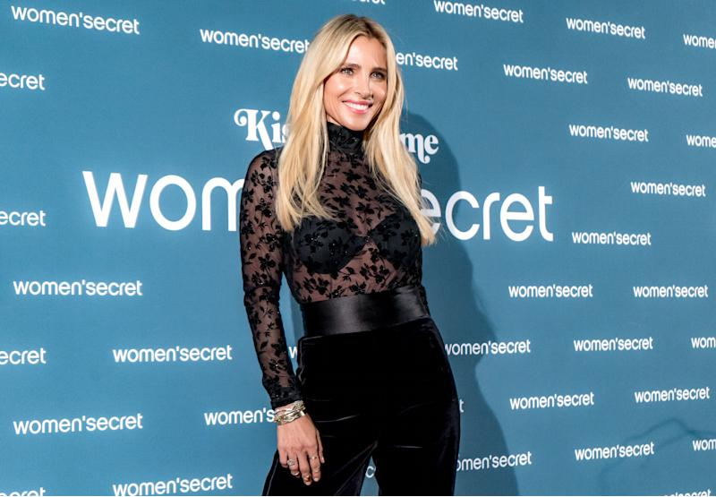 A photo of actress Elsa Pataky wearing a black lace top and black pants on the red carpet for the 'KissMas Time' by Women'Secret at Santa Barbara Palace on November 20, 2019 in Madrid, Spain.