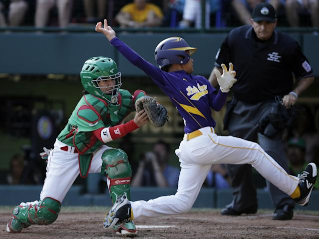 Aguadulce, Panama's Daniel Fernandez, right, is tagged out by Nuevo Laredo, Mexico's Eduardo Abrego while trying to score on a hit by Edwin Nieto in the fifth inning of a baseball game at the Little League World Series, Thursday, Aug. 23, 2012, in South Williamsport, Pa. Panama won 2-1. (AP Photo/Matt Slocum)