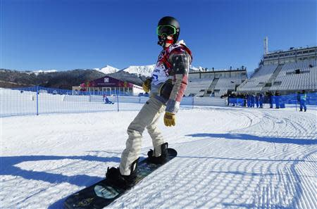 U.S. snowboarder Shaun White cruises out of the finish area during snowboard slopestyle training at the 2014 Sochi Winter Olympics in Rosa Khutor February 3, 2014. REUTERS/Mike Blake