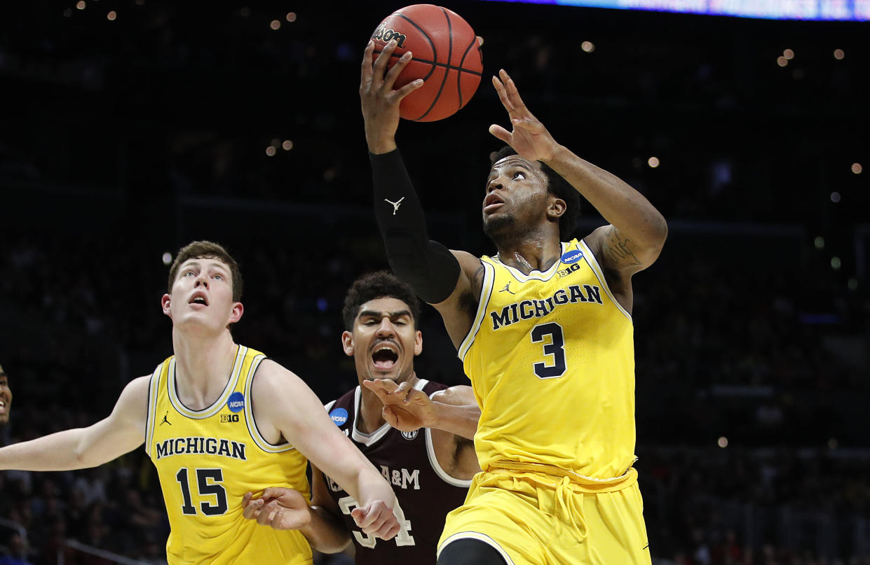Michigan guard Zavier Simpson (3) shoots against Texas A&M during the first half of an NCAA men's college basketball tournament regional semifinal Thursday, March 22, 2018, in Los Angeles. (AP Photo/Jae Hong)