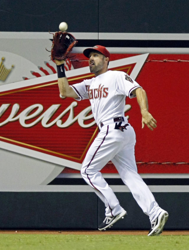 Arizona Diamondbacks left fielder Adam Eaton (6) makes the running catch for the out in the first inning during a baseball game against the Baltimore Orioles on Tuesday, Aug. 13, 2013, in Phoenix. (AP Photo/Rick Scuteri)