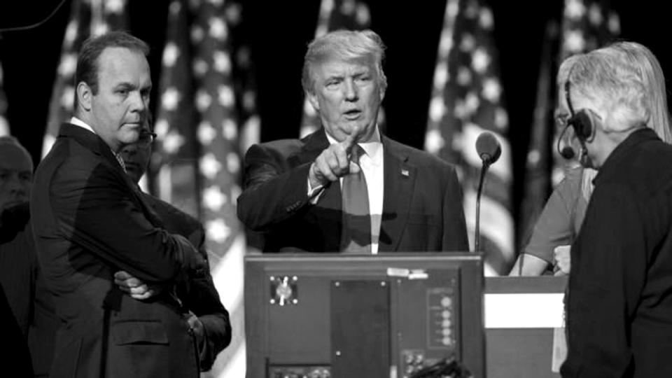 Then-GOP presidential candidate Donald Trump on stage with Rick Gates, left, at the Republican National Convention, July 21, 2016, in Cleveland. (Evan Vucci/AP)