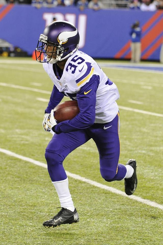 Minnesota Vikings cornerback Marcus Sherels (35) runs back a punt return for a touchdown during the first half of an NFL football game against the New York Giants Monday, Oct. 21, 2013 in East Rutherford, N.J. (AP Photo/Bill Kostroun)