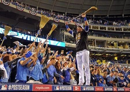 Oct 5, 2014; Kansas City, MO, USA; Kansas City Royals catcher Salvador Perez (13) celebrates with fans after defeating the Los Angeles Angels in game three of the 2014 ALDS baseball playoff game at Kauffman Stadium. The Royals won 8-4 advancing to the ALCS against the Baltimore Orioles. Mandatory Credit: Peter G. Aiken-USA TODAY Sports