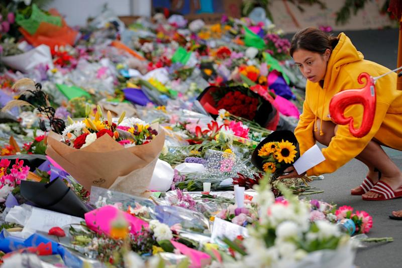 Mourners lay flowers near the Linwood mosque in Christchurch. (AP)