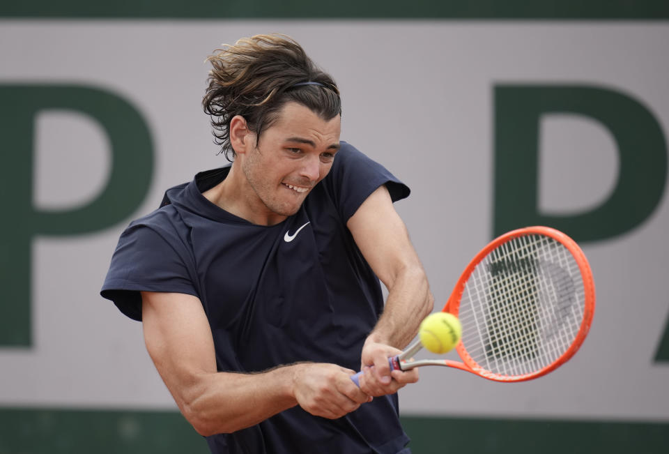 United States's Taylor Fritz plays a return to Germany's Dominik Koepfer during their second round match on day 5, of the French Open tennis tournament at Roland Garros in Paris, France, Thursday, June 3, 2021. (AP Photo/Christophe Ena)