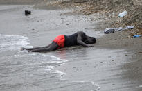A man lies on the ground on the beach after swimming to the area at the border of Morocco and Spain, at the Spanish enclave of Ceuta, on Tuesday, May 18, 2021. Ceuta, a Spanish city of 85,000 in northern Africa, faces a humanitarian crisis after thousands of Moroccans took advantage of relaxed border control in their country to swim or paddle in inflatable boats into European soil. (AP Photo/Javier Fergo)