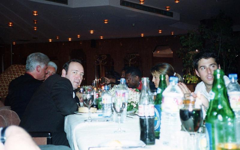 Kevin Spacey with Bill Clinton at a dinner during their trip - CDWES/The Mega Agency