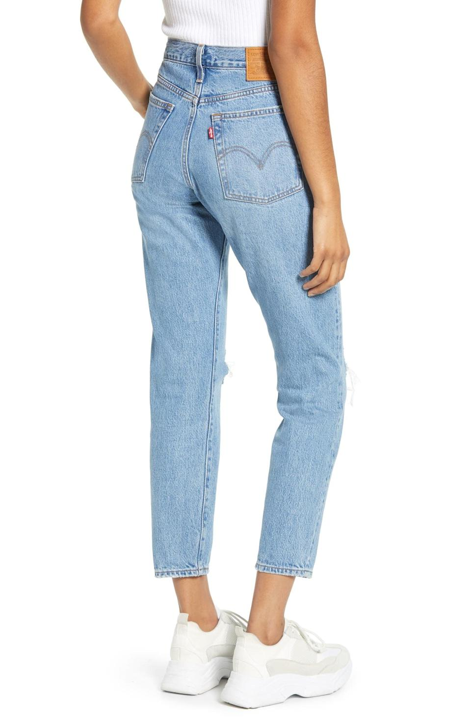 "<p>You can't go wrong owning the <a href=""https://www.popsugar.com/buy/Levi-Wedgie-Icon-Fit-Ripped-Straight-Leg-Jeans-585712?p_name=Levi%27s%20Wedgie%20Icon%20Fit%20Ripped%20Straight%20Leg%20Jeans&retailer=shop.nordstrom.com&pid=585712&price=98&evar1=fab%3Aus&evar9=45615413&evar98=https%3A%2F%2Fwww.popsugar.com%2Ffashion%2Fphoto-gallery%2F45615413%2Fimage%2F47583295%2FLevi-Wedgie-Icon-Fit-Ripped-Straight-Leg-Jeans&list1=shopping%2Cdenim%2Cwinter%2Cwinter%20fashion&prop13=mobile&pdata=1"" class=""link rapid-noclick-resp"" rel=""nofollow noopener"" target=""_blank"" data-ylk=""slk:Levi's Wedgie Icon Fit Ripped Straight Leg Jeans"">Levi's Wedgie Icon Fit Ripped Straight Leg Jeans</a> ($98).</p>"