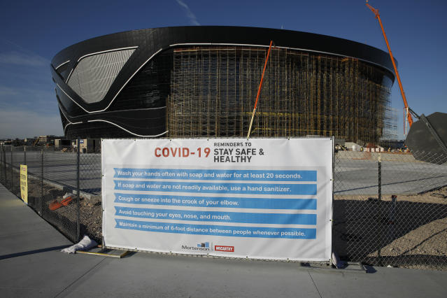 As workers fall ill and Las Vegas sits still, construction continues as Allegiant Stadium. (AP Photo/John Locher)