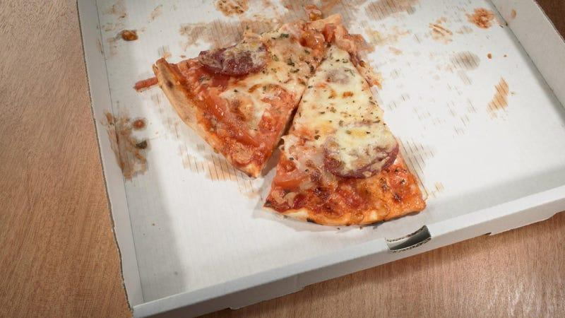 two slices of pizza in delivery box