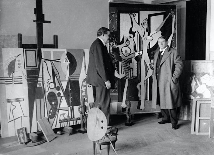 Pablo Picasso (1881-1973), Spanish painter and sculptor poses in his studio in 1922 Paris, France.