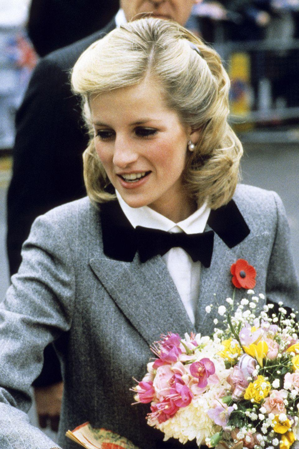 <p>The Princess pinned back her growing locks with two barrettes while at a charity event in London. </p>