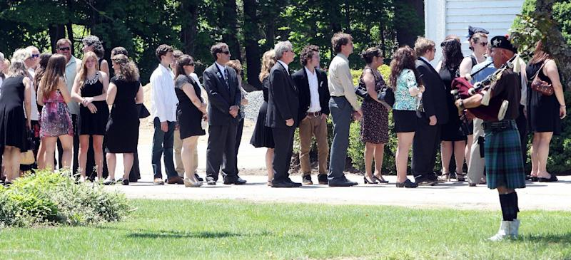 Family and friends arrive for a memorial service for Nancy Lanza Saturday June 1, 2013 in Kingston, N.H. Lanza's 20-year-old son, Adam Lanza, killed her at their home in Newtown, Conn., on Dec. 14 and then drove to Sandy Hook Elementary School, where he killed the children and six school employees before committing suicide. (AP Photo/Jim Cole)