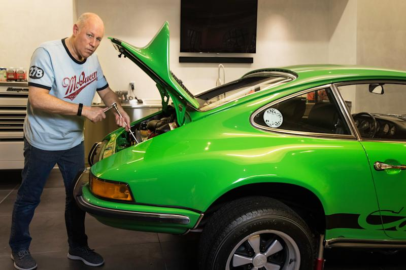 Jeffrey Sprecher, working on a 1973 Porsche 2.7RS in Viper Green at his home in Atlanta on July 27, 2018.