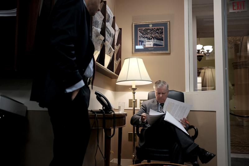 Sen. Lindsey Graham (R-S.C.) goes over his notes before a press conference on the IG report at the Capitol on Capitol Hill in Washington, D.C. on Dec. 9, 2019. | Gabriella Demczuk for TIME