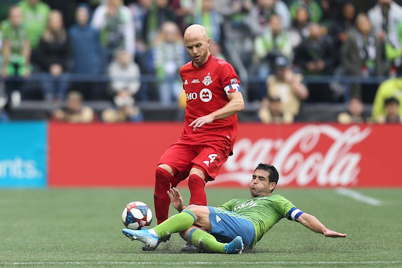 Michael Bradley (4) will miss several months after undergoing surgery for the ankle injury he suffered in Toronto FC's MLS Cup loss in November. (Omar Vega/Getty)