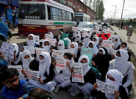 Schoolgirls holding placards sit in a road during a protest against the rape of an eight-year-old girl in Kathua, near Jammu, a teenager in Unnao, Uttar Pradesh, and an eleven-year-old girl in Surat, Gujarat, in Srinagar