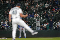 Fans in the stands cheer as Seattle Mariners relief pitcher Kendall Graveman (49) reacts after Mariners third baseman Dylan Moore caught a line drive hit by Los Angeles Dodgers' Will Smith to end the top of the seventh inning of a baseball game, Monday, April 19, 2021, in Seattle. (AP Photo/Ted S. Warren)