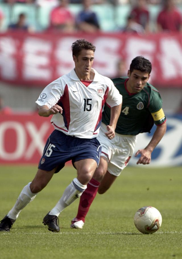 Wolff, shown here battling Mexican great Rafa Marquez, played for the the U.S. at the 2002 and 2006 World Cups. (Michael Stahlschmidt/Getty)