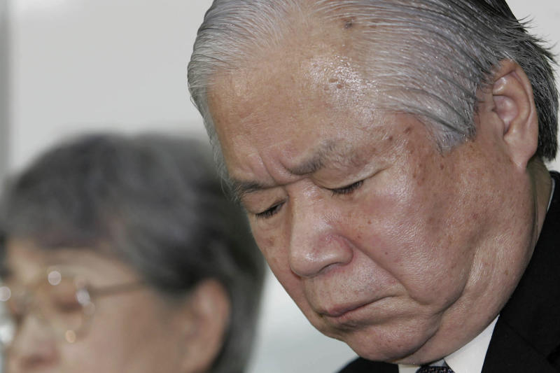 FILE - In this Nov. 15, 2004, file photo, Shigeru Yokota pauses as he and his wife Sakie speak during a press conference by families of the abduction victims in Tokyo after an urn containing the cremated remains of their daughter Megumi brought back from Pyongyang by Japanese officials. Shigeru Yokota died of natural causes before he was able to meet his daughter again, his group said Friday, June 5, 2020. He was 87. (AP Photo/Koji Sasahara, File)
