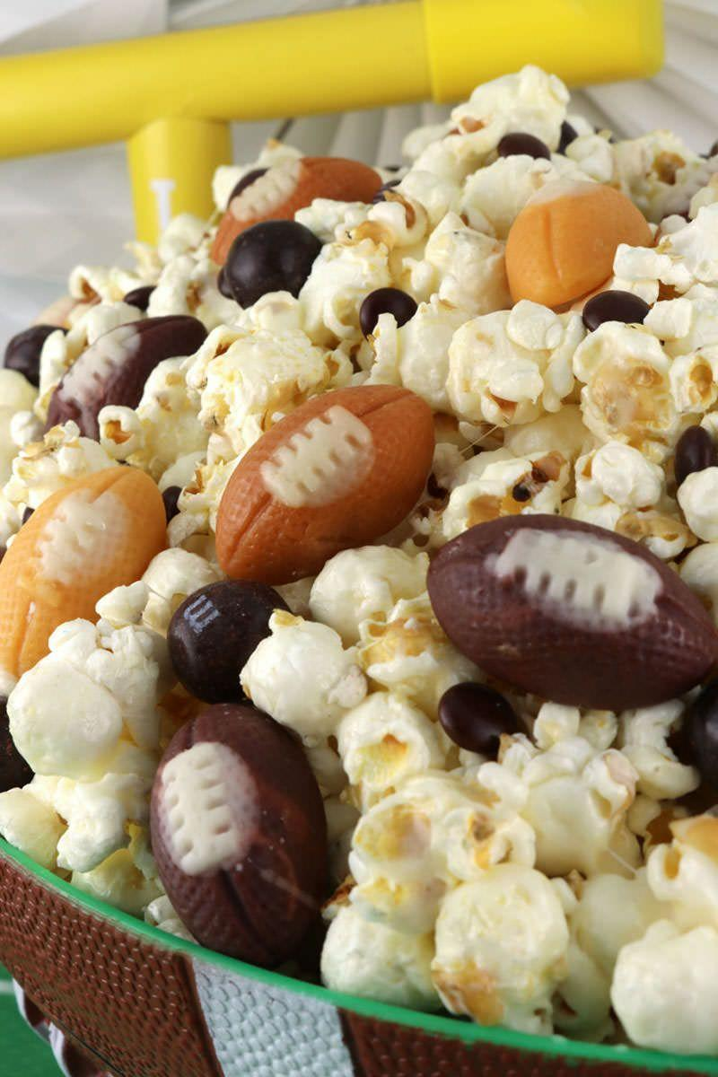 """<p>Turn a bowl of popcorn into the perfect dessert with this recipe that uses a marshmallow coating and football-shaped candies.</p><p><strong>Get the recipe at <a href=""""https://www.twosisterscrafting.com/game-day-popcorn/"""" rel=""""nofollow noopener"""" target=""""_blank"""" data-ylk=""""slk:Two Sisters Crafting"""" class=""""link rapid-noclick-resp"""">Two Sisters Crafting</a>.</strong></p><p><strong><a class=""""link rapid-noclick-resp"""" href=""""https://www.amazon.com/Stone-Beam-Hard-Anodized-Non-Stick-Aluminum/dp/B07BG7BFWZ/?tag=syn-yahoo-20&ascsubtag=%5Bartid%7C10050.g.5080%5Bsrc%7Cyahoo-us"""" rel=""""nofollow noopener"""" target=""""_blank"""" data-ylk=""""slk:SHOP SAUCEPANS"""">SHOP SAUCEPANS</a><br></strong></p>"""