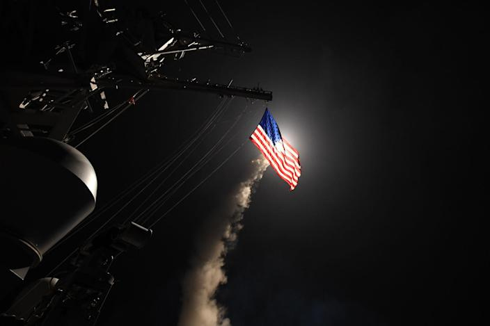 <p>APR. 7, 2017 – The guided-missile destroyer USS Porter fires a Tomahawk land attack missile from the Mediterranean Sea. The USS Porter was one of two destroyers that fired a total of 59 cruise missiles at a Syrian military airfield in retaliation for a chemical attack that killed scores of civilians this week. The attack was the first direct U.S. assault on Syria and the government of President Bashar al-Assad in the six-year war there. (Photo: Ford Williams/U.S. Navy via Getty Images) </p>